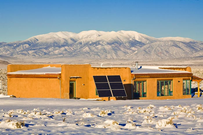 Adventure, landscape, and lifestyle photographer sustainable, solar powered, strawbale home office in New Mexico