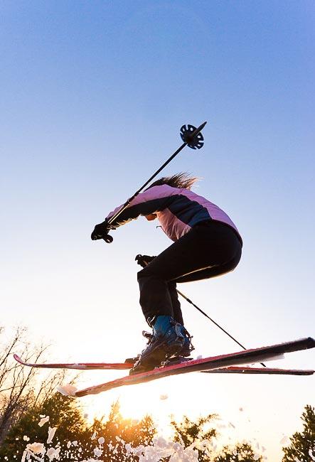 Woman skier jumping in air Utah
