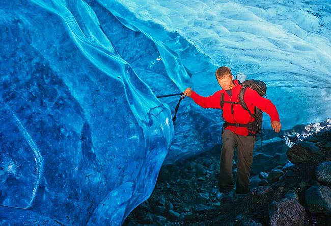 Young adult male on a glacier hiking adventure under Wrangell-St. Elias National Park's Root Glacier, Alaska