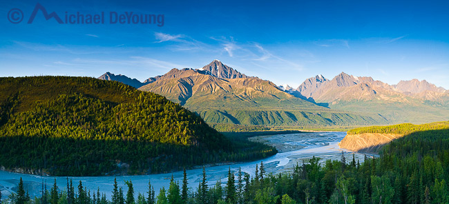 Alaska panoramic landscape. View of the upper Matanuska River and the north face of the Chugach Mountains seen near Hicks Creek along the Glenn Highway north of Anchorage, Alaska.