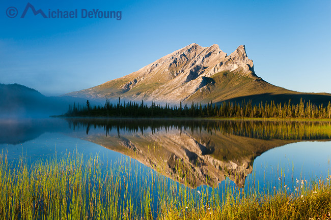 Alaska landscape. Brooks Range, above the Arctic Circle a view of Mt. Sukapak and reflection in early morning off the Dalton Highway north of Coldfoot, Alaska.