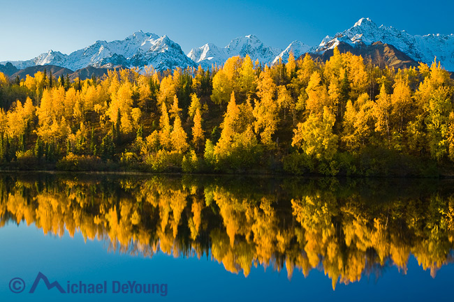 Alaska landscape. Autumn view of the north face of the Chugach Mountains above the Matanuska Valley, Chugach National Forest. Reflection in Weiner Lake off the Glenn Highway.
