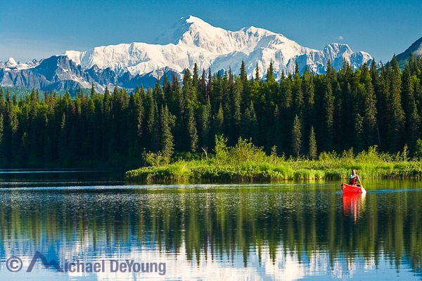 Alaska landscape and recreation. Alaska's highest peak, Mt. McKinley rising above Byers Lake and a canoeist. Chulitna Valley, Byers Lake State Park.