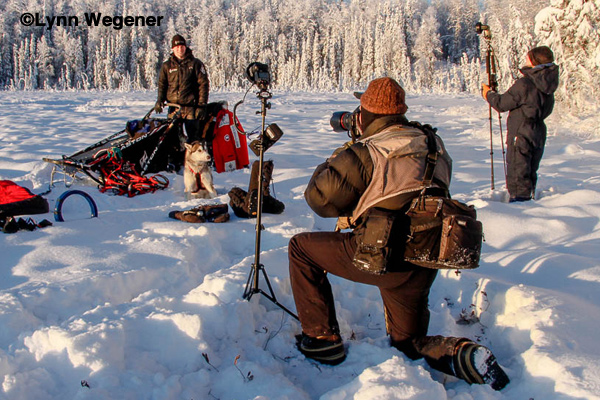 On assignment in Willow, Alaska in sub-zero weather. Lynn Wegener and Karen Combs with Canon 600EX-RT speedlights equiped with Spinlight 360 light modifiers with Michael DeYoung shooting environmental portaits of 2012 Iditarod Champion Dallas Seavey.