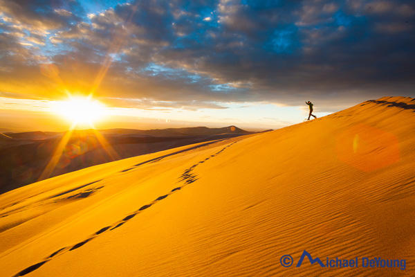 Running down sand dunes, Great Sand Dunes National Park, Colorado