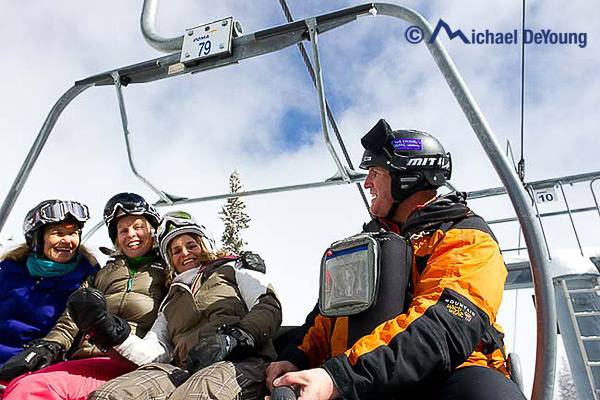 photographer-skiers-chairlift-taos