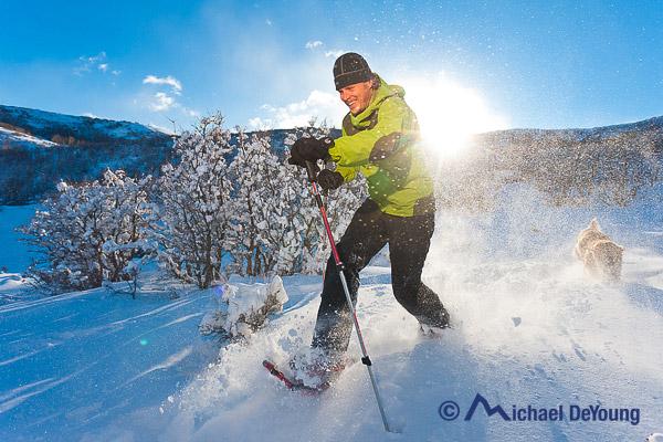 man-snowshoeing-utah