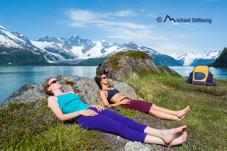 women-sunbathing-grass-prince-william-sound-alaska
