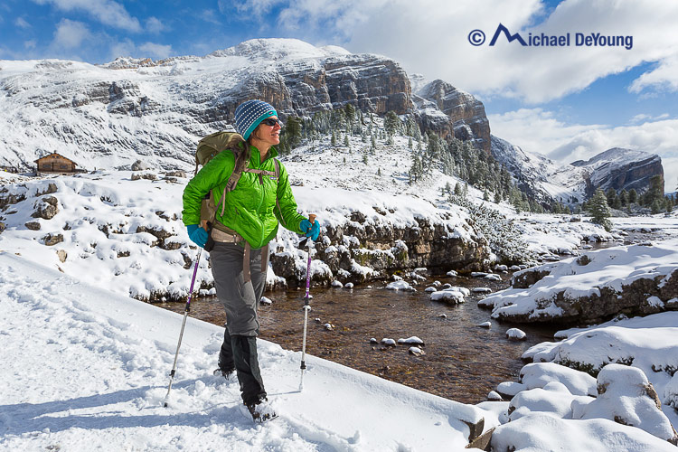 hiker in autumn snow, Dolomites, Italy