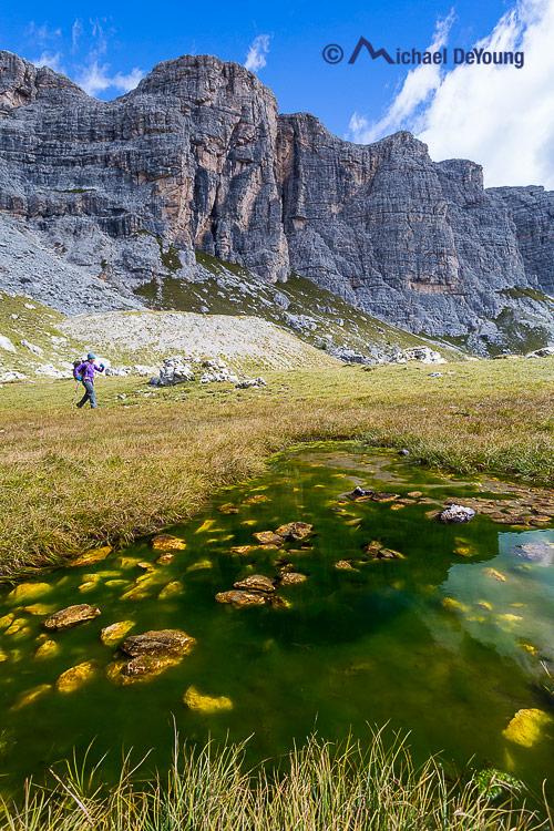 hiker along Alta Via 1, Dolomites, Italy