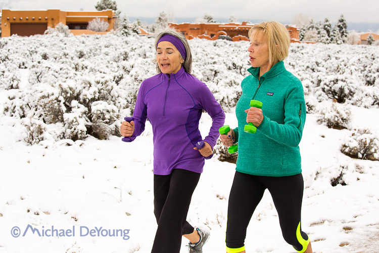 Personal Trainer and client power walking with weights, Taos New Mexico