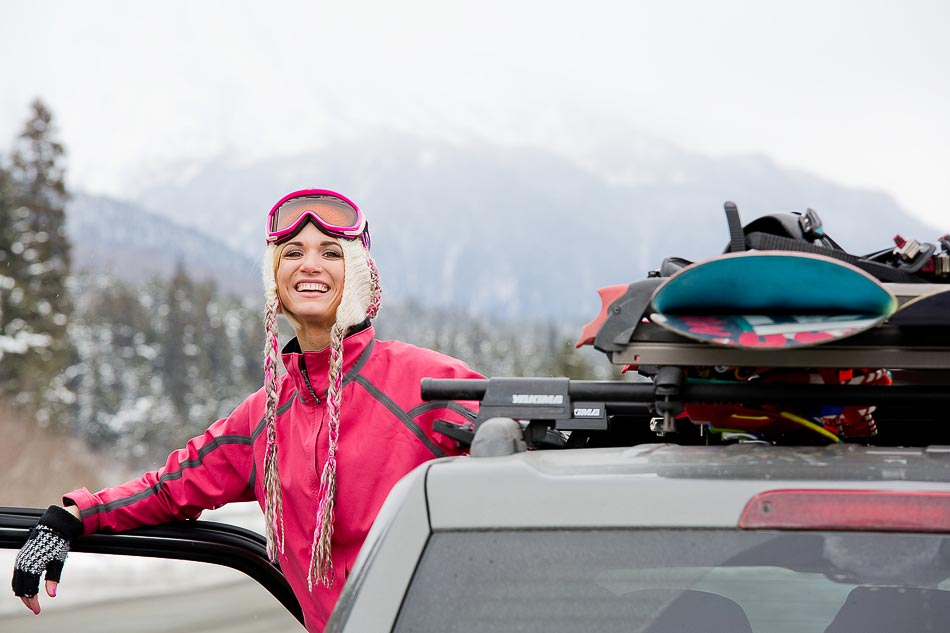 New Mexico Photographers Alaska Winter Lifestyle Photos - Young woman motorist taking in the view along Turnagain Pass