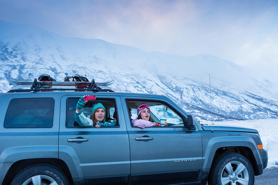 New Mexico Photographers Alaska Winter Lifestyle Photos - young adults on scenic road trip