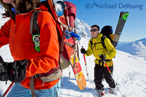 New Mexico Photographers Alaska Winter Lifestyle Photos - Young couple climbing with backcountry skis at Hatcher Pass