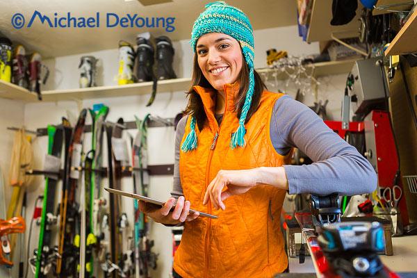 New Mexico Photographers Alaska Winter Lifestyle Photos - Ski technician with iPad