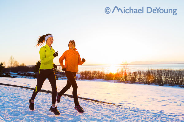 New Mexico Photographers Alaska Winter Lifestyle Photos - women running along Coastal Trail