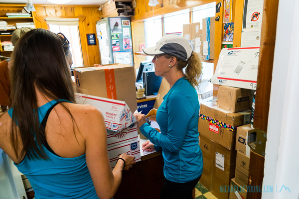Hikers picking up a general delivery box at Stehekin Post office.  They get over a 1000 general delivery boxes for PCT Thru hikers.