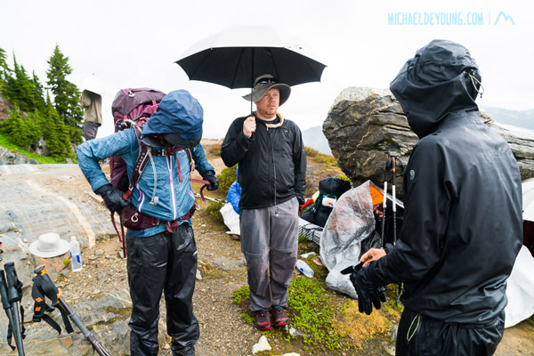 Gang of SOBOs in the rain and hail at Mica Lake, waiting for visibility to clear before heading up Fire Creek Pass.  Liam, from Scotland with umbrella, was the first SOBO I met a few miles north of Harts Pass.  Cheri, Andrew and I went first despite the horrible weather.  New hail and snow covered the trail and boot pack on the pass so we had to do a few minutes of GPS navigation to find the trail.