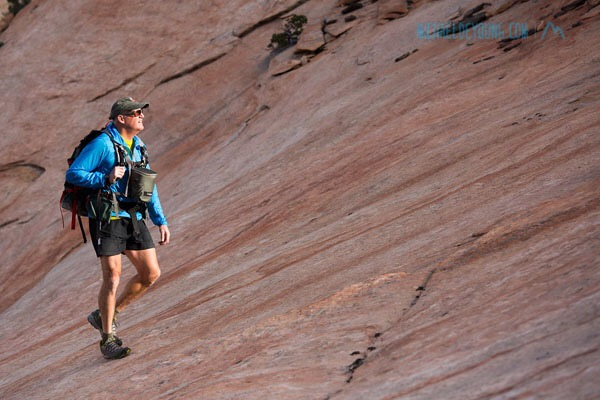 – Photographer Michael DeYoung working in Zion National Park carrying his custom made McHale Pack and F-stop Gear Navin case.