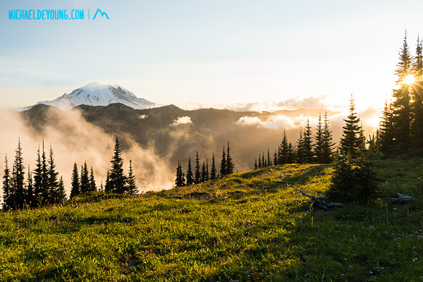 "Sunset and Mt. Rainier from Scout Pass on the PCT at 6500"" with fog in valley below."