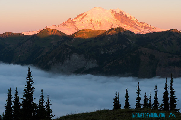 "Sunrise and Mt. Rainier from Scout Pass on the PCT at 6500"" with fog in valley below.  Same vantage point as sunset image"
