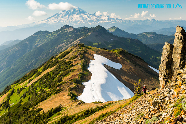 PCT in Goat Rocks Wilderness, Washington.  Juliet ascending the Knife Edge with Mount Rainier in the background.  I think this says it all about why we hike the PCT.  I still love the Washington Cascades.
