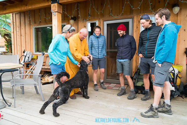 "Venerable Kozen with his dog Ven and fellow SOBO hikers Juliette, Thomas, Pierre, and Leo on the porch of Trout Lake Abbey with ""Trail Angel"" Lauri"