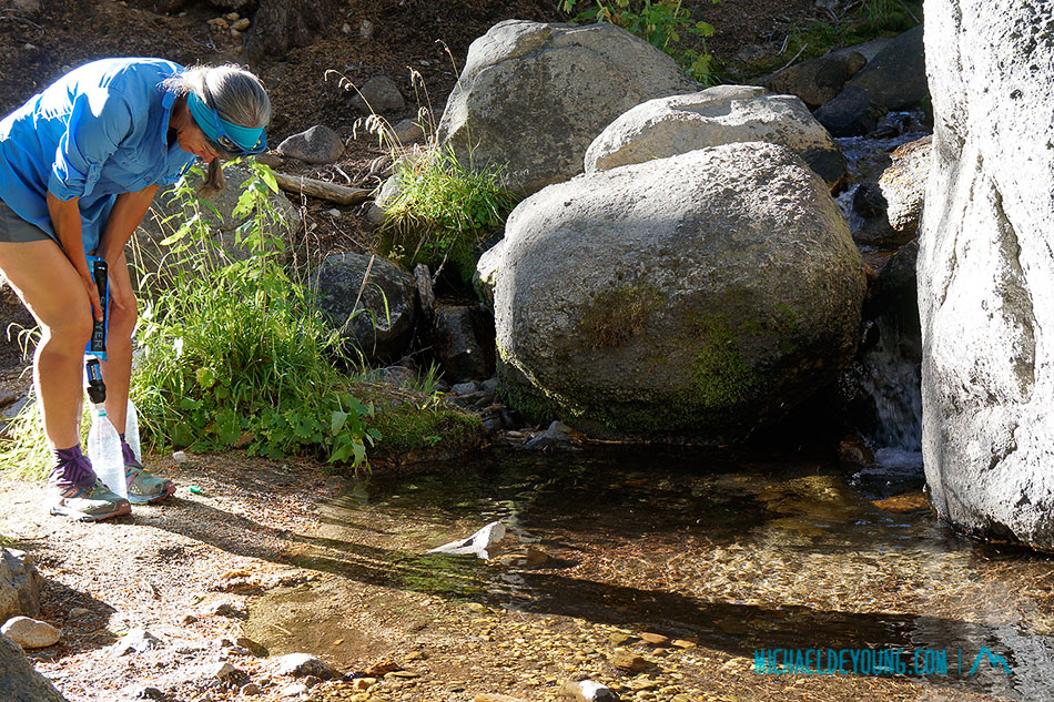 Almost every PCT hiker who filters their water uses the Sawyer filter which Lauri is using here in a beautiful clear and very cold Sierra mountain stream