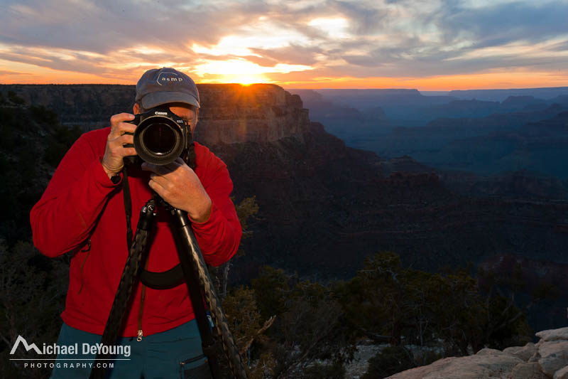 Man photographing sunset on the South Rim of the Grand Canyon