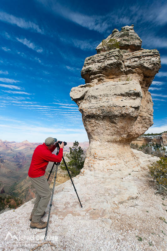 Man photographing on the South Rim of the Grand Canyon