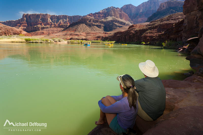 Image of a couple backpackers resting along Colorado River just above Tanner Rapids in the Grand Canyon