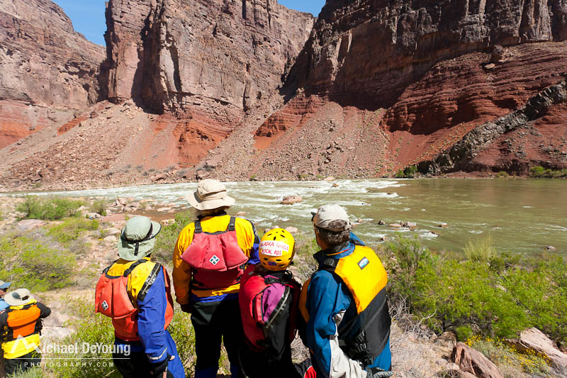 Group of river rafters from Alaska scouting Hance Rapids along the Colorado River, Grand Canyon National Park