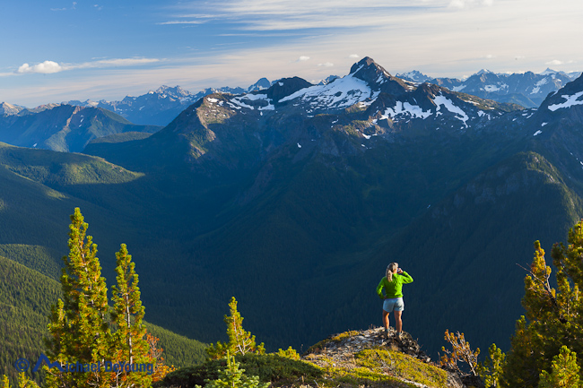 Image of woman enjoying her morning cup of tea at camp on Devil's Dome, Pasayten Wilderness, North Cascades, Washington -