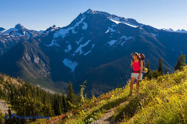 Image of woman female backpacker backpacking on Devil's Ridge Trail, Jack Mountain, Pasayten Wilderness, North Cascades, Washington