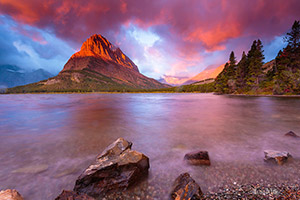 Swiftcurrent Lake at sunrise with strong chinook winds and orographic clouds over the Continental Divide at sunrise, with Grinell Point, fall, Glacier National Park, MT